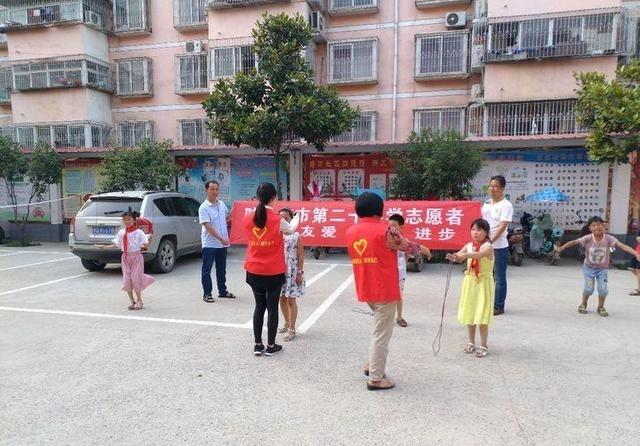驻马店市第二十社区志愿者服务塘坊小学开展四义务教育小学总结a社区图片