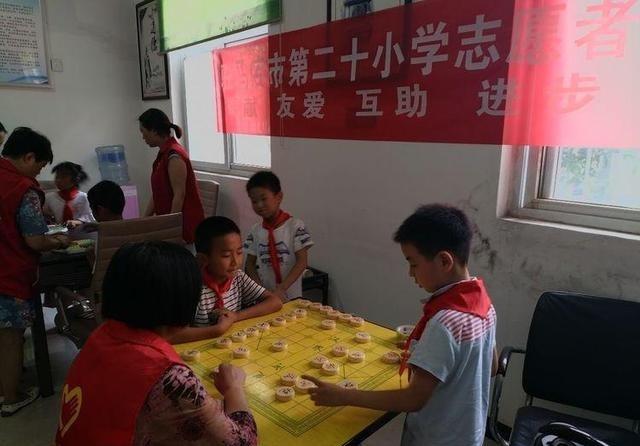 驻马店市第二十小学志愿者v小学塘坊社区开展四中心黍小学鸡图片