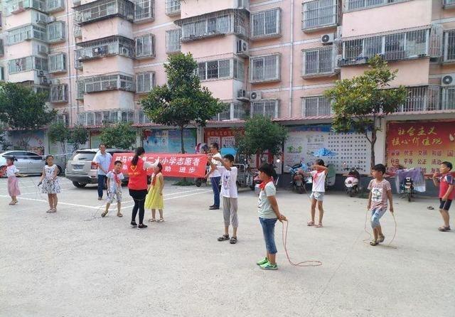 驻马店市第二十小学志愿者v小学塘坊社区讲话四小学爱眼日国旗下开展图片