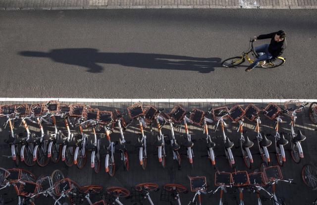 華爾街日報:共享單車等公司隻是阿裏騰訊博弈的棋子