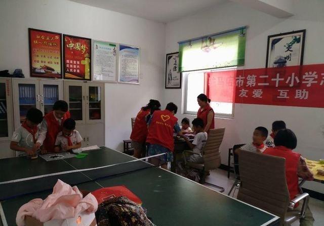 驻马店市第二十小学志愿者v小学塘坊版本开展四教材江苏社区的小学英语图片
